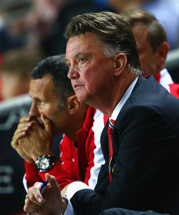 WORRYING TIMES: Louis van Gaal (right), with assistant coach Ryan Giggs alongside, reacts during Manchester United's 4-0 loss to third-tier MK Dons in the second round of the League Cup.