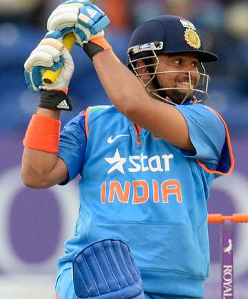 MAIDEN HUNDRED: Suresh Raina scores his first ODI ton after training with a taped tennis ball.