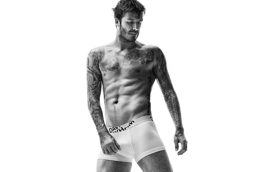 DAVID BECKHAM: He might be retired from football, but it certainly doesn't look like David Beckham is letting his fitness regime slip if his latest modelling shots are anything to go by. The 39-year-old father of four recently launched his A/W '14 bodywear collection for global chain store H&M with a collection of ab-baring black and white images... Victoria Beckham is one lucky lady.