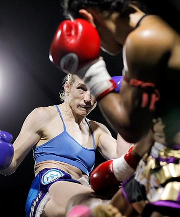 SERENITY: The ring is a place of calm for Wellington kickboxer Gentiane Lupi, seen here beating three-time world champion Alicia Pestana last Saturday.