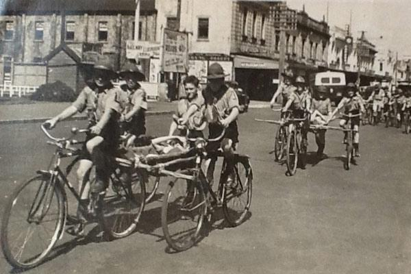Victory parade: Trevor Muir's mother snapped these photo of local scouts at a Victory War Bond Parade in Victoria St, around 1942 or 1943. Muir's mother was leader of St George's Church cub pack in Frankton. The scouts lashed their staves to the bicycles to form support for stretchers. The group at the rear were cycle couriers. ''These parades were quite common and were used to raise money for the war effort,'' Muir said.