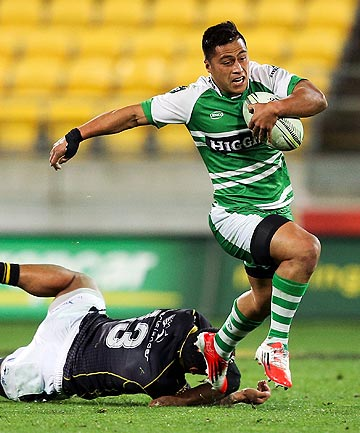 TURBO BOOST: Manawatu's Jason Emery skips away from a Wellington defender during his sides victory over the hosts in the capital tonight.