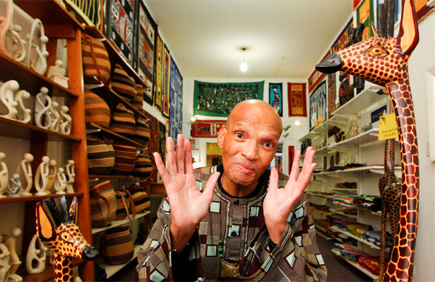 OFF TO JAIL: Lewis E Scott at his shop Kwanzaa when he sold it last year. At the time he was already facing a charge  of rape.