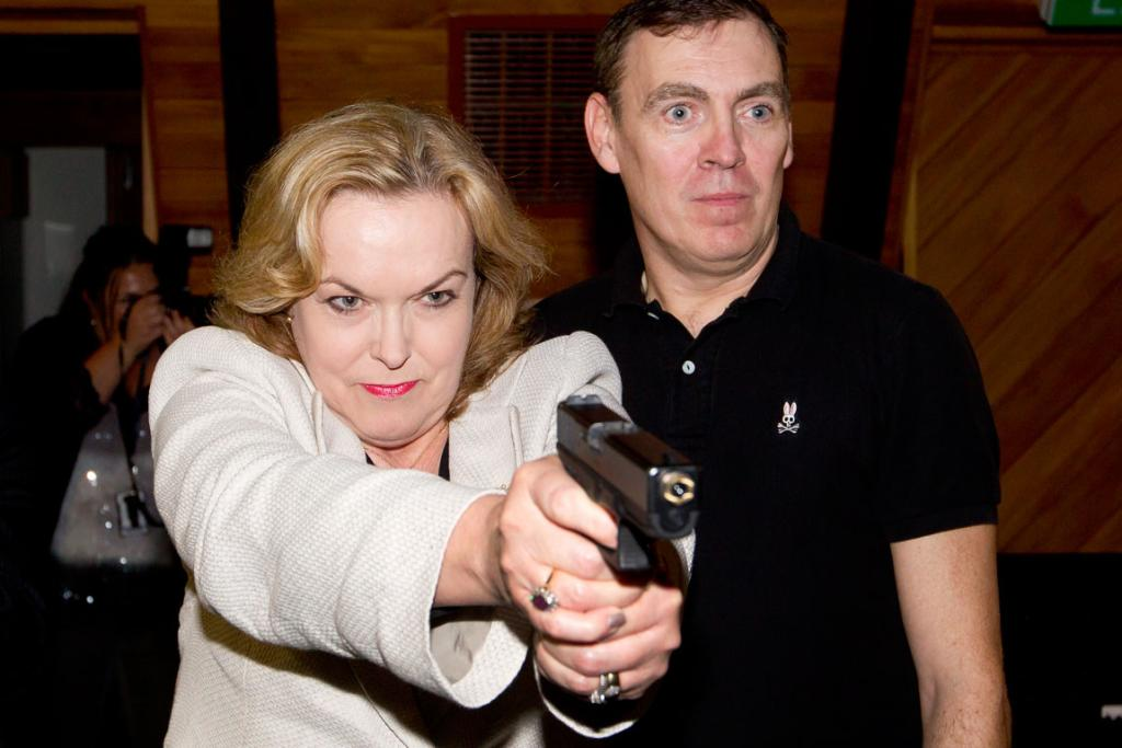 CRUSHER: Judith Collins receives firearms training from Vince Anthony of Lockheed Martin in 2011.