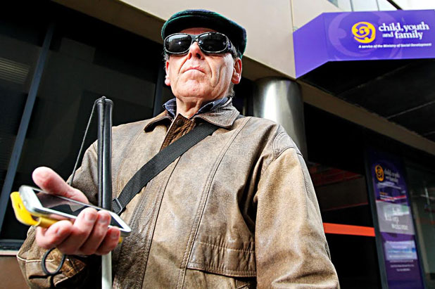 Harry Harris, 62, trying to ring someone regarding his appointment at the closed Work and Income office today was unable to get an answer.