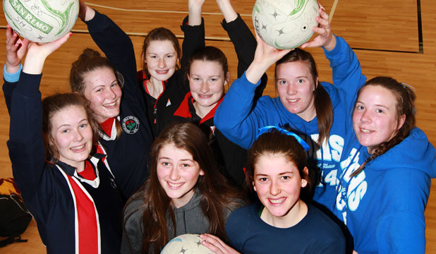 PARADOX: Twins Rachel and Sarah Marshall, 16, Georgia and Rose Rhind, 15, Sophie and Abby Erwood, 17, and, in front, Kate and Georgia Heffernan, 14, are all taking to the court this week at the South Island secondary schools netball tournament.