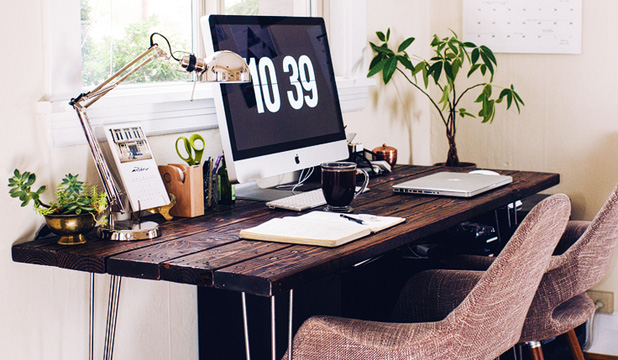 GO GREEN: Granted, we don't all have the luxury of working in an immaculately-styled home office like this one, but boosting productivity in any office environment could be as simple as adding some greenery.