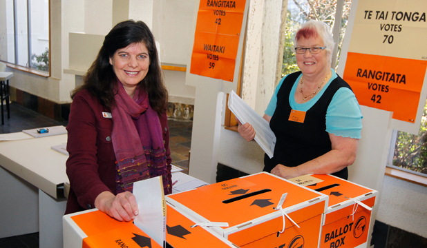 EARLY VOTER: Rangitata returning officer Brigitte Kempf casts her advance vote as election worker Mary Davey watches.