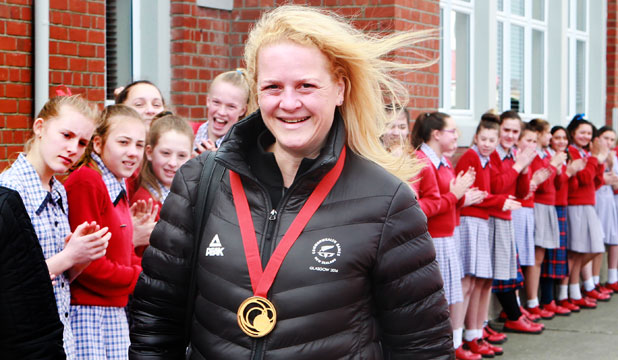 WHERE IT ALL STARTED: Commonwealth Games gold medallist Sally Johnston walks through a guard of honour at her former high school, Southland Girls'.
