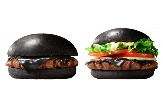GOTH BURGERS: Burger King Japan's Kuro Pearl and Kuro Diamond creations are made with black buns, bamboo charcoal cheese and squid ink sauce.
