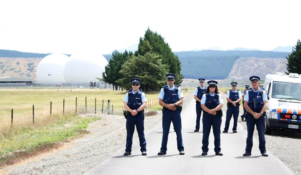 ON GUARD: Police are pictured outside the GCSB's Waihopai spy base during a January protest.