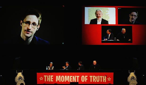 "Edward Snowden and Julian Assange appear via video at Kim Dotcom's ""Moment of Truth"""