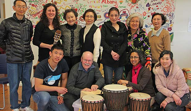FEELING GOOD: The senior music therapy group, back, from left: Richard Hong, music therapist Sophie Buxton, Park Won Ok, Myung Hee, translator Myungshim Kim, Julia Yoon, Emily. Front, from left: Social work student Cassidy Yeung, Colin Webster, Grief Centre support person Mallika Krishnamurthy, and social work student Sabrina Hu.