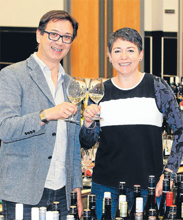 CELEBRATING EXCELLENCE: Marlborough Museum chief executive Steve Austin and Wine Competition co-director Belinda Jackson toast day one of the judging at the Marlborough Wine Show.