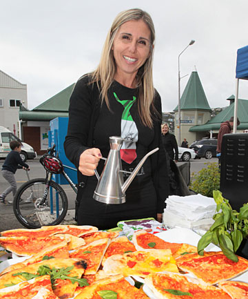 SUMNER SUMMER: Tilde Romano offers pizza at a stall at the Sunday morning market in Sumner.