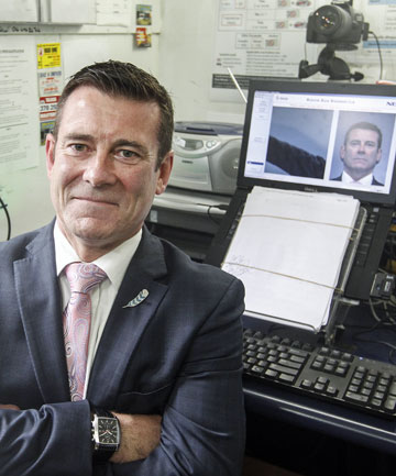 MAKING HIS MARK: Police Minister Michael Woodhouse in front of his police mugshot, taken with new Booze Bus Biometric technology introduced in Wellington.