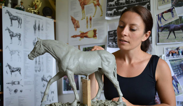 FOOTSTEPS: Local artist Nicola Jain Lewis with her 30cm clay sculpture of Zabeel. Her father Rick Lewis produced a bronze of Zabeel's father Sir Tristram 30 years ago.