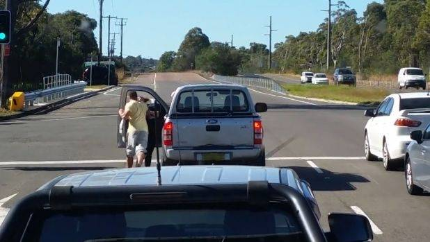 Man filmed punching woman in the face on NSW road