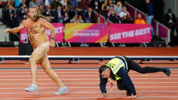Naked streaker with 'Peace and Love' intrudes track before Bolt's final race