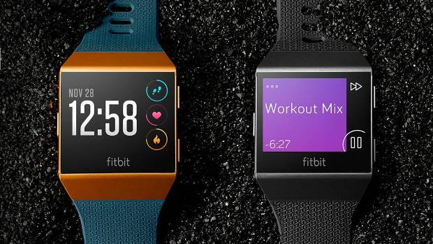 Fitbit unveils first smartwatch - and wireless headphones