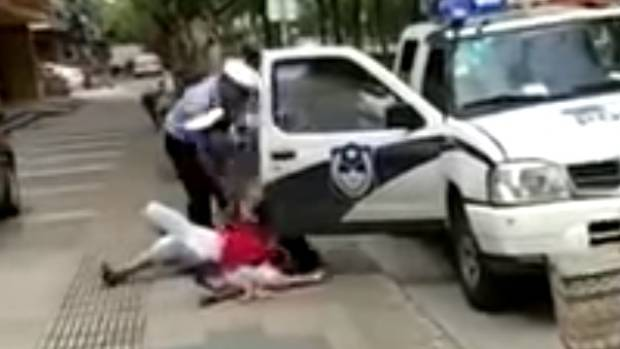 Chinese Cop Body Slams Woman Holding Her Baby