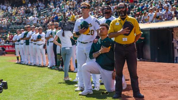 'We need some change': First MLB anthem protest sparks reaction