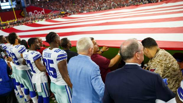 Jerry Jones, Cowboys take a knee before National Anthem