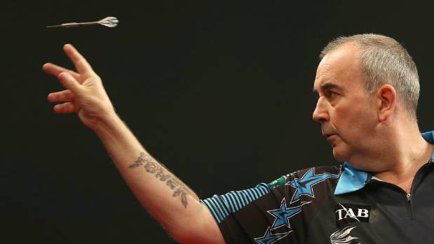 Phil Taylor beats Chris Dobey to reach second round