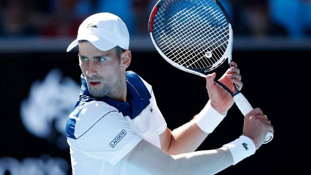 Djokovic elbows Young out to reach second round