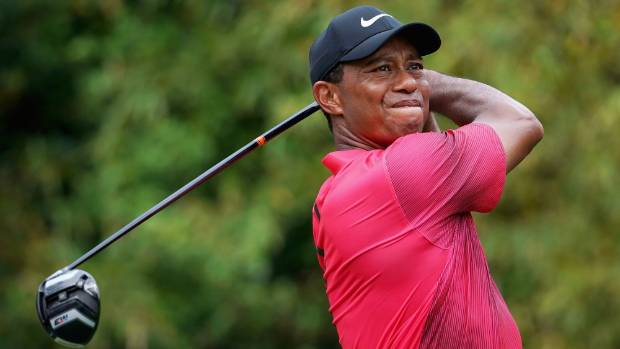 Tiger Woods made a furious charge up the leaderboard Saturday