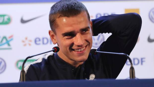 David Vincent       France's Antoine Griezmann smiles as he answers journalists questions