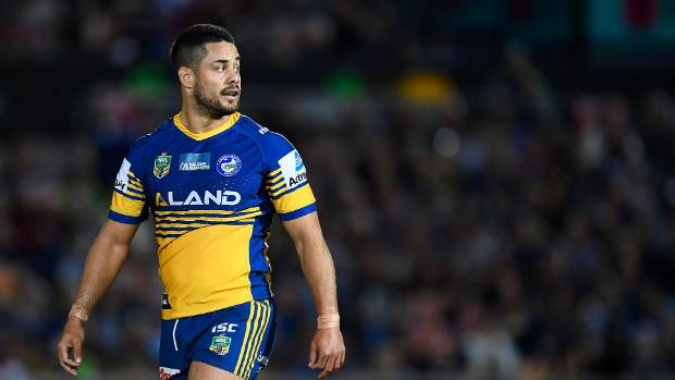 Silent Jarryd Hayne reports to police