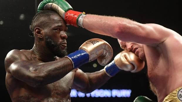 AP       Deontay Wilder lands a left to Tyson Fury's jaw and looks to follow up[ with his deadly right hand during their drawn WBC heavyweight title fight